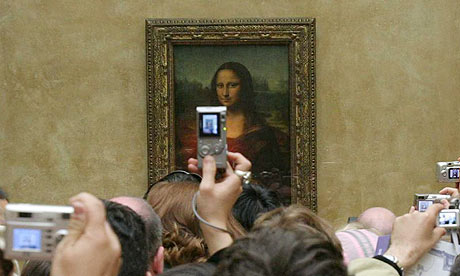 Visitors crowd in front of Mona Lisa
